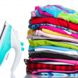 Pile of colorful clothes and electric iron isolated on white — Stock Photo #11048737