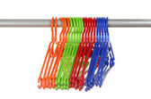 Plastic hangers in row isolated on white — Stock fotografie