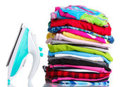Pile of colorful clothes and electric iron isolated on white — Stock Photo