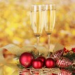 Two glasses with christmas decoration on yellow - Стоковая фотография