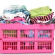 Clothes in pink plastic basket isolated on white — Stock Photo #11070875