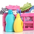 Clothes with detergent in pink plastic basket isolated on white — Stock Photo #11070877