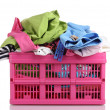 Clothes in pink plastic basket isolated on white — Stock Photo #11070880