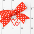 Stock Photo: Calendar page with hearts and bow on St.Valentines Day