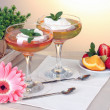 Fruit jelly in glasses and fruits on table in cafe — Stock Photo #11071413