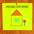 Stock Photo: Poster about renting house with key on wooden background