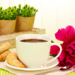 Cup hot chocolate, cookies and flower on table in cafe — Stock Photo