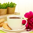 Cup hot chocolate, cookies and flower on table in cafe — Stock Photo #11071490