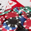Stock Photo: The red poker table with playing cards and poker chips