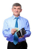 Businessman believes the money isolated on white — Stock Photo