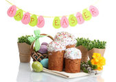 Beautiful Easter cakes, colorful eggs in basket and pussy-willow twigs isolated on white — Stock Photo