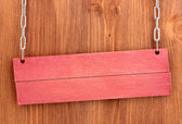 Color wooden sign board on wooden background — Stock Photo