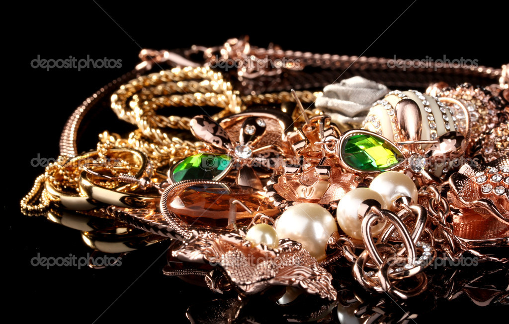 Various gold jewellery on black — Stock Photo #11070847