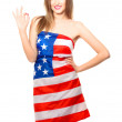 Beautiful young woman wrapped in American flag isolated on white — Stock Photo #11088489