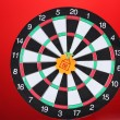 Stock Photo: Darts with stickers depicting the life values on colorful background. The darts hit the target