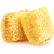Golden honeycombs isolated on white — Stock Photo