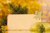 Blank postcard, Christmas balls and fir-tree on yellow background — Stock Photo