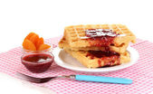 Tasty waffles with jam on plate isolated on white — Fotografia Stock