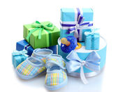 Beautiful gifts, baby's bootees and dummy isolated on white — Stock Photo