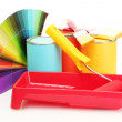 Stock Photo: Tin cans with paint, roller, brushes and bright palette of colors isolated on white