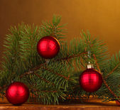 Christmas tree with beautiful New Year's balls on wooden table on brown background — Foto Stock