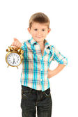 Funny little boy with alarm clock isolated on white — Stock Photo