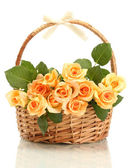 Beautiful bouquet of roses in basket isolated on white — Stock Photo