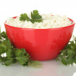 Cottage cheese with parsley and dill in red bowl isolated on white — Stock Photo #11102685
