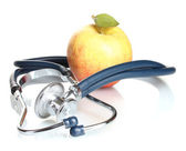 Medical stethoscope and apple isolated on white — Stock Photo
