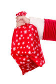 Santa Claus hand holding bag of gifts isolated on white — Stock Photo