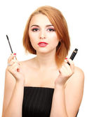 Beautiful young woman with mascara — Stock Photo