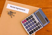 Rental agreement on wooden background close-up — Stock Photo