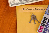 Folder with the settlement statement on wooden background close-up — Stock Photo