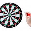 Dart in hand and dartboard  isolated on white — Stock Photo