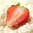 Strawberry on the cottage cheese close-up — Stock Photo