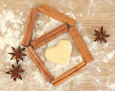 House lined with cinnamon on wooden table close-up — Stock Photo