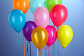 Colorful balloons on blue background close-up — Stock Photo