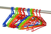 Plastic hangers in row isolated on white — Stock Photo