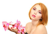 Portrait of sexy young woman with pink orchid flower — Stock Photo