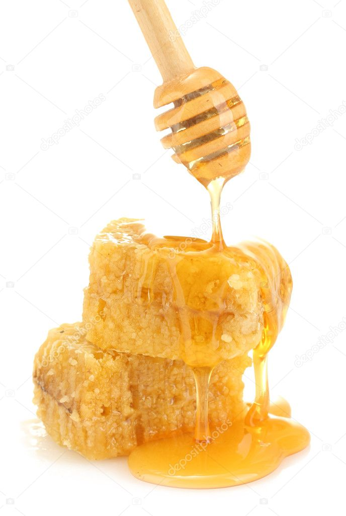 Golden honeycombs and wooden drizzler with honey isolated on white  Stock Photo #11132819