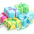 Bright gifts with bows isolated on white — Stock Photo