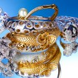 Beautiful silver and gold bracelets and rings on blue background — Zdjęcie stockowe