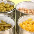 Stock Photo: Open tin cans of peas, corn, beand french beclose-up
