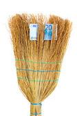 Broom sweep the euro close-up — Stock Photo