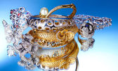 Beautiful silver and gold bracelets and rings on blue background — Stock Photo