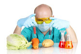 Scientist injecting GMO into the vegetables — Stok fotoğraf