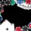 Frame made of playing cards and poker chips on black background close-up — Stock Photo #11160113