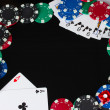 Frame made of playing cards and poker chips on black background close-up — Stock Photo