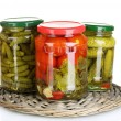 Jars of canned vegetables isolated on white - Stok fotoğraf