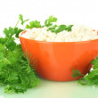 Cottage cheese with parsley and dill in orange bowl isolated on white — Stock Photo #11169220